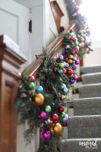 Holiday Home Tour | inspiredbycharm.com LOVE this colorful jewel tone stair garland!