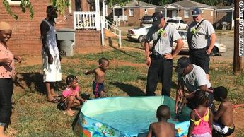 These kids were carrying water in pots to fill up their pool. Then firefighters stopped to help.
