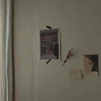 art taped to the wall. flower taped to the wall. sincere. honest. unpretentious. to the point. sweet.