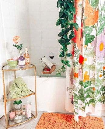 On top of delightful towel storage, this bathroom also boasts a glass of wine and plenty of style inspiration: very nice! #bathroomstorage #decor #style