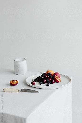 Platter of fruit on table by Ellie Baygulov for Stocksy United