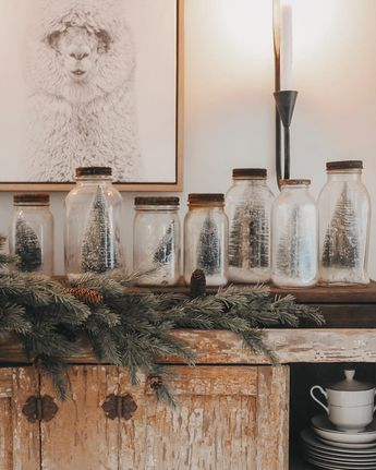 Group bottle brush trees in old jars