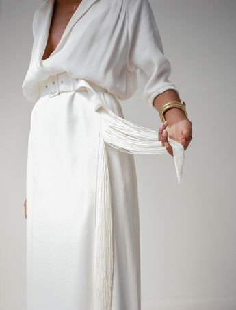 all white outfit, women's fashion clothing style, white low cut top blouse, tube maxi skirt, oversized fabric belt, minimal