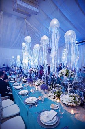 under the sea wedding motif with hanging jellyfish table decorations - great aquarium wedding idea