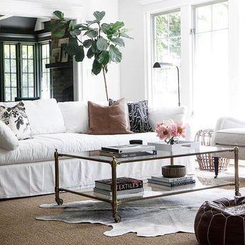 It's always fun to see you tag and share your #wshome style! We love seeing our Stevenson Coffee Table in this bright and airy living room designed by @parkandoakdesign! Shop it directly through the link in our profile.