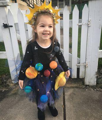 Solar system Halloween costume with light up skirt and 3D planets. #solarsystem #outofthisworld #halloween #kidscostume