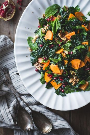 Herbed Kale Salad with Persimmon, Pomegranate and Maple-Cumin Dressing Recipe -- the perfect fall salad recipe and a delicious healthy vegetable-filled Thanksgiving side dish to try!