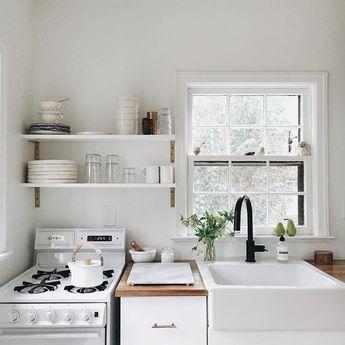 Cute & clean white kitchen // butcher block counter top // farmhouse apron sink