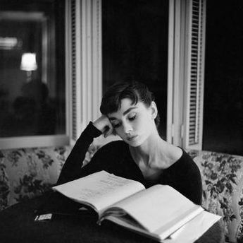 Audrey Hepburn Reading, candid, 1950s, Black and white, old photo, vintage antique, photography, pic