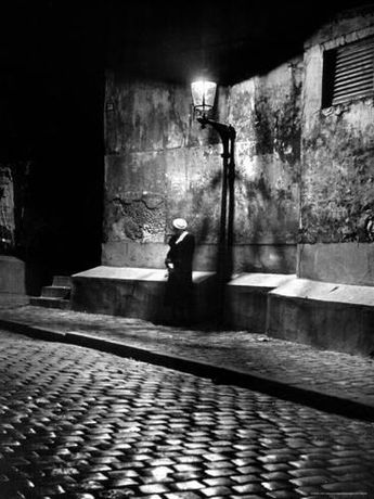 Photographic Print: Woman under Streetlight in Montmartre at Night by Alfred Eisenstaedt : 24x18in