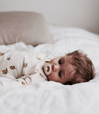 new born baby sleeping photo