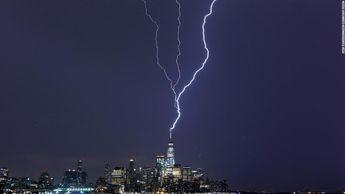 Lightning strikes New York's One World Trade Center on Tuesday, October 2, CNN photos