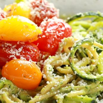 Burst Tomato and Zucchini Spaghetti tossed with a simple, creamy, vegan avocado sauce. This healthy recipe is ready in 30 minutes! #glutenfree #sugarfree #vegan #healthy #dinner #cleaneating | pinchofyum.com
