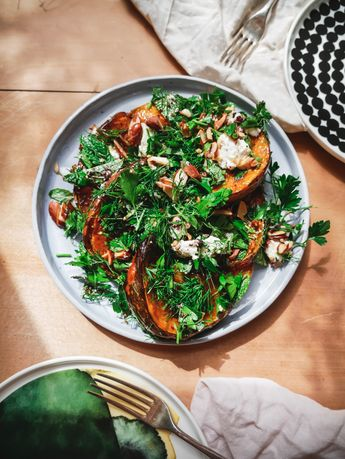 Pumpkin Moon Salad with fresh green herbs, goat's feta and toasted almonds