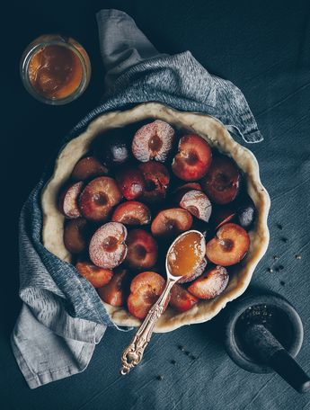 Plum pie with honey and black pepper