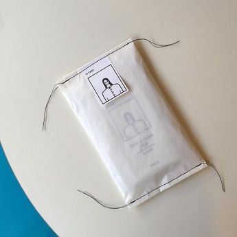 Eco friendly paper packaging. Sewed glassine parcel recycle-able packaging with illustrated line drawing.