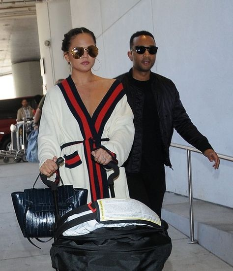 Singer John Legend was seen departing LAX airport with his wife Chrissy Teigen and their baby girl, Luna in Los Angeles, California on March 16, 2017. The singer recently opened up about Chrissy's postpartum depression and helping her through tough times.