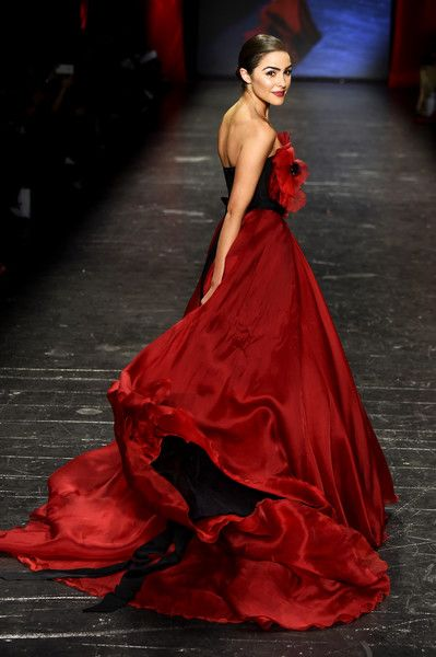 Actress Olivia Culpo walks the runway at The American Heart Association's Go Red For Women Red Dress Collection 2016 Presented By Macy's at The Arc, Skylight at Moynihan Station on February 11, 2016 in New York City.