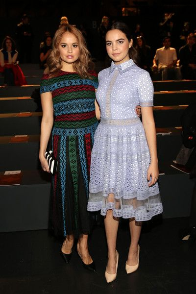 Actresses Debby Ryan, (L) and Bailee Madison attends the Tadashi Shoji Fall 2016 fashion show during New York Fashion Week: The Shows at The Arc, Skylight at Moynihan Station on February 12, 2016 in New York City.
