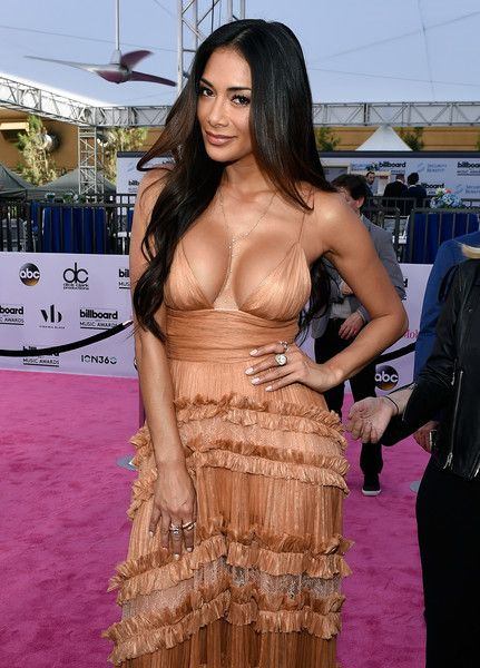 Singer Nicole Scherzinger poses at SiriusXM's 'Hits 1 in Hollywood' red carpet broadcast on SiriusXM's SiriusXM Hits 1 channel before the Billboard Music Awards.