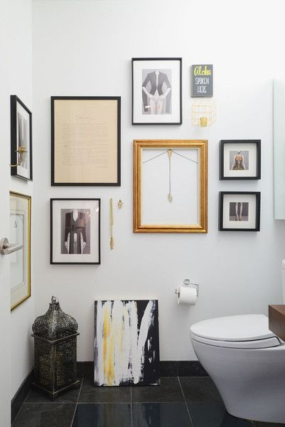 Noa Santos Manhattan Apartment: A gallery wall comprised of old and new frames creates visual interest in the bathroom.