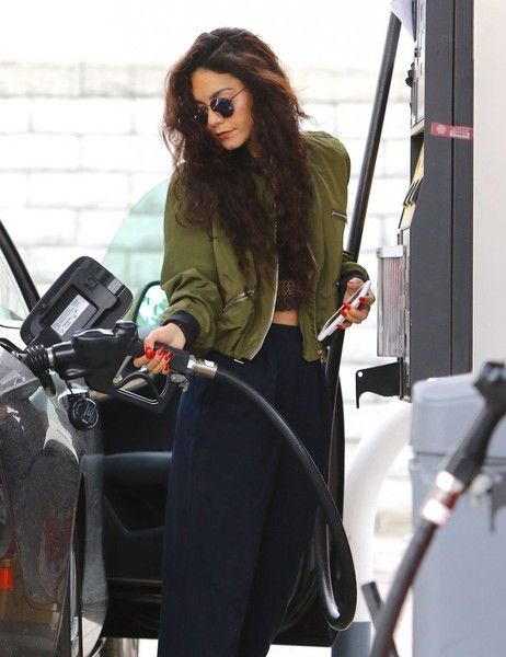 Actress Vanessa Hudgens stops for gas in Studio City, California on May 23, 2016. Vanessa spent her time sending texts while waiting for her car to fill up.