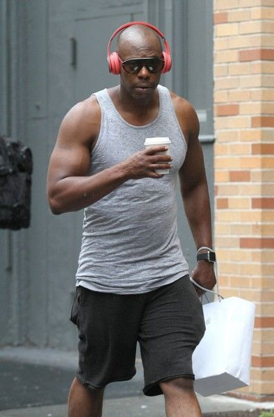 Dave Chappelle listens to music after shopping on a rainy day in Manhattan's Soho neighborhood in NYC.