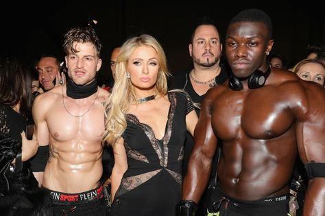 Paris Hilton poses with models backstage ahead of the Plein Sport show during Milan Men's Fashion Week Fall/Winter 2017/18.