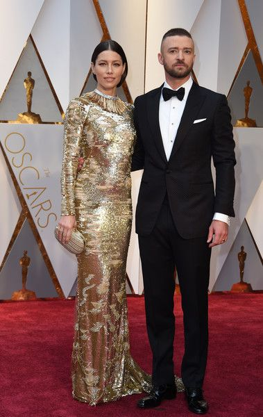 """Nominees for Best Music (Original Song) """"Can't Stop The Feeling"""" from Trolls Justin Timberlake and his wife US actress Jessica Biel arrive on the red carpet for the 89th Oscars on February 26, 2017 in Hollywood, California.  / AFP / VALERIE MACON"""