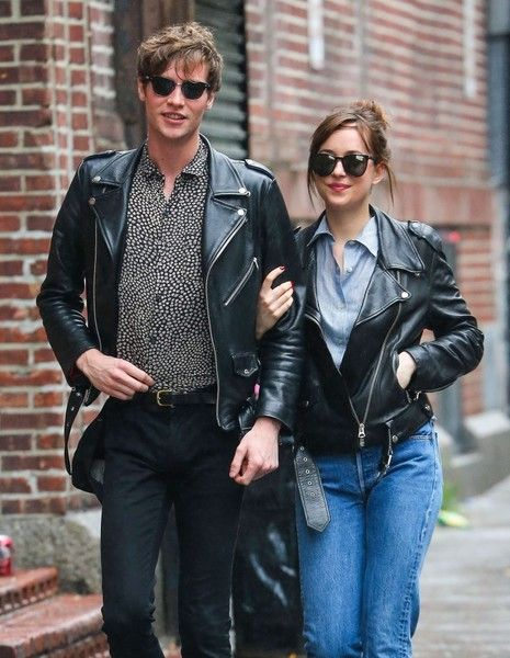Couple Dakota Johnson and Matthew Hitt are spotted out for a stroll on a rainy day in New York City.