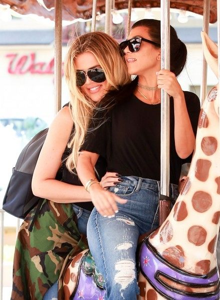 Reality stars Kourtney Kardashian and Khloe Kardashian get silly as they shop at the mall in Encino.