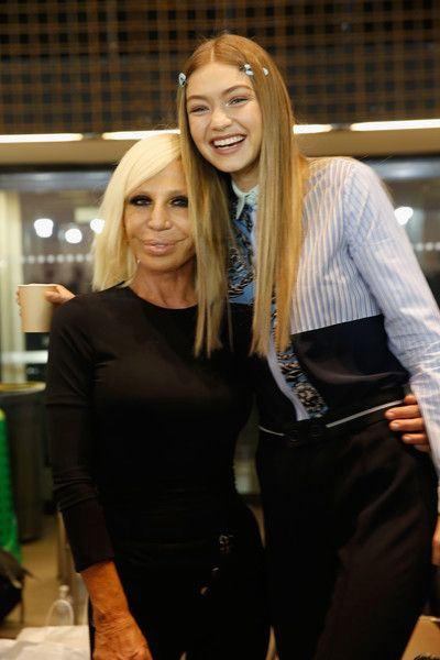 Donatella Versace (L) and Gigi Hadid (R) seen backstage ahead of the Versace show during Milan Fashion Week Spring/Summer 2017 on September 23, 2016 in Milan, Italy.