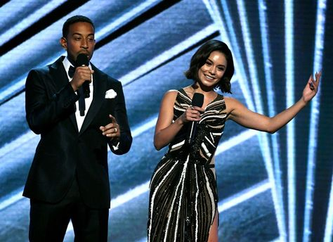 Co-hosts Ludacris and Vanessa Hudgens speak onstage during the 2017 Billboard Music Awards.