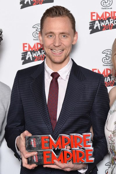Tom Hiddleston poses in the winners room with his two awards for Empire Hero and Best TV Series for 'The Night Manager' at the THREE Empire awards in London.