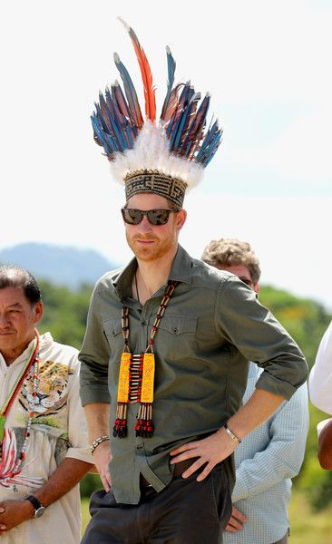Prince Harry is presented with a headdress by dancers in Sumara Village in the Guyana Hinterland on day 13 of an official visit to the Caribbean.
