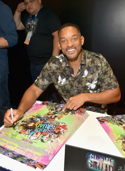 Will Smith from the cast of 'Suicide Squad' participates in an autograph session for fans in DC's 2016 Comic-Con booth.