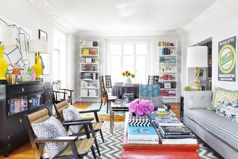 Eclectic Modern Traditional  Coffee Table: Armchairs, a coffee table, and a couch atop a chevron-patterned area rug.
