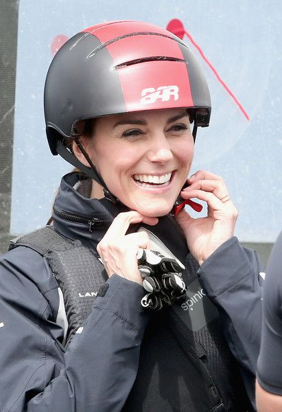 Catherine, Duchess of Cambridge, patron of the 1851 Trust, adjusts her helmet as she boards a Land Rover BAR Racing catamaran at Land Rover BAR on May 20, 2016 in Portsmouth, England. The Duchess of Cambridge is launching the 1851 Trust's two sailing projects and meeting people involved in the project. Afterwards she will open the 'Tech Deck' Education Centre at the heart of the base.