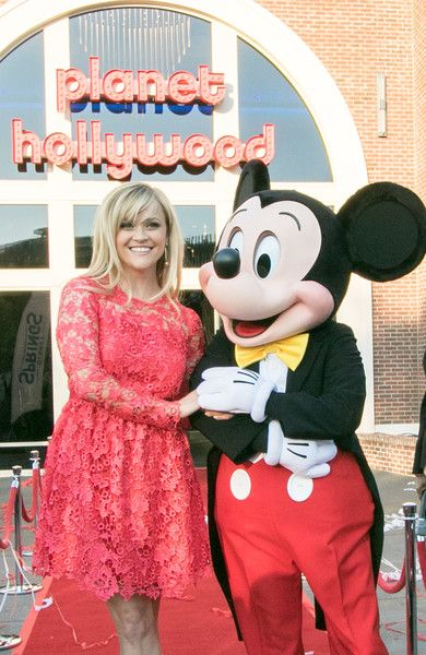 Reese Witherspoon and Mickey Mouse Officially Open Planet Hollywood Disney Springs on March 17, 2017 in Orlando, Florida.