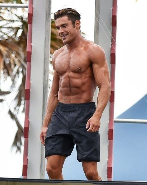 Actor Zac Efron shows off his toned beach bod while filming a shirtless scene for the upcoming 'Baywatch' film in Miami, Florida on March 8, 2016.