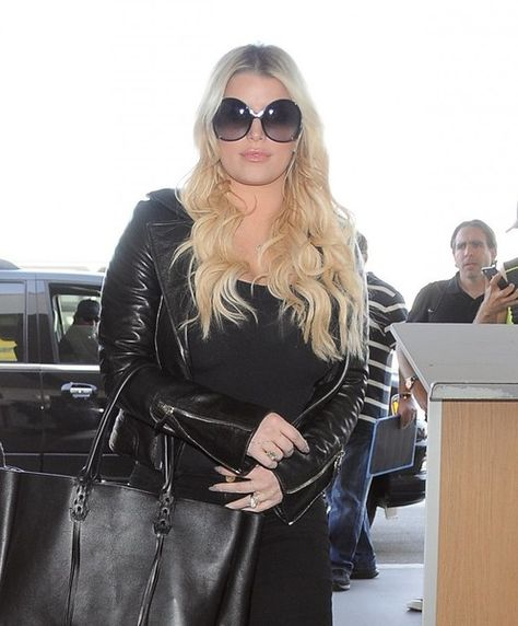 Jessica Simpson is spotted departing from LAX with her husband Eric Johnson.