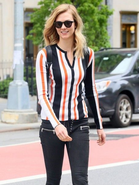 Model Karlie Kloss departs from a hair salon in New York City.