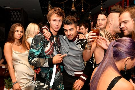 Ansel Elgort and Joe Jonas  attend a celebration with Republic Records and Guess after the 2016 MTV Video Music Awards.