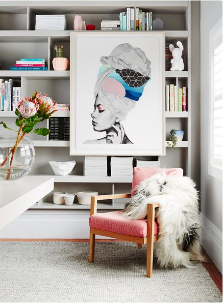 love the blush chair and the cool way of displaying the art