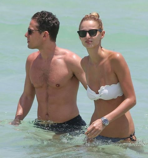 Karolina Kurkova relaxes on the beach with her husband in Miami, Florida on May 3, 2016.  She just got to the sunny state after spending the previous night in New York at the MET Gala.
