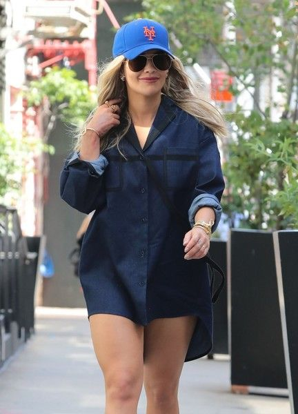 Rita Ora rocks a denim shirt and Mets hat while out and about in New York City.
