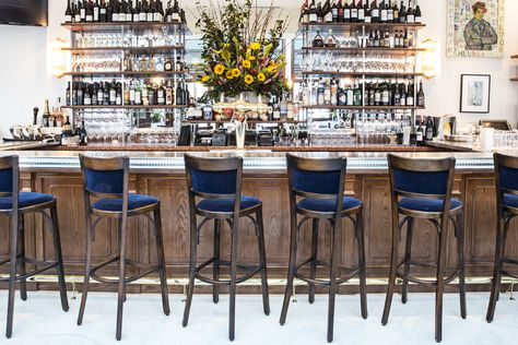 A chic line-up of contemporary barstools perfectly complement the oh-so-French pewter bar top at Le Bilboquet's newest outpost in Atlanta.
