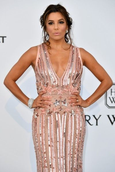 US actress Eva Longoria poses as she arrives for amfAR's 24th Cinema Against AIDS Gala.