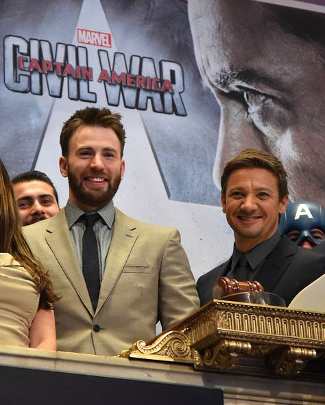 """Actors Chris Evans (L) and Jeremy Renner ring The New York Stock Exchange Opening Bell To Promote Release Of """"Captain America: Civil War"""" at The New York Stock Exchange on May 03, 2016 in New York, New York."""