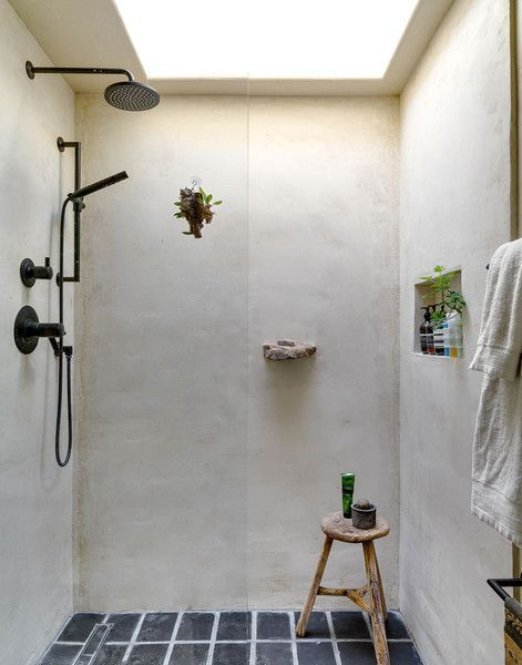 A Spanish-Style Compound for Indoor-Outdoor Living in L.A.: The bathroom features a concrete shower stall, vintage tile from the 1920s, and a rock from Big Sur that the couple embedded into the wall as a soap dish.